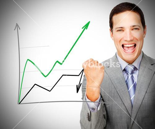 Businessman standing smiling behind graph
