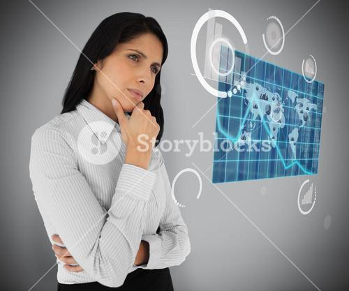 Business woman looking at world map hologram