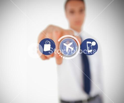 Businessman touching on airplane symbol