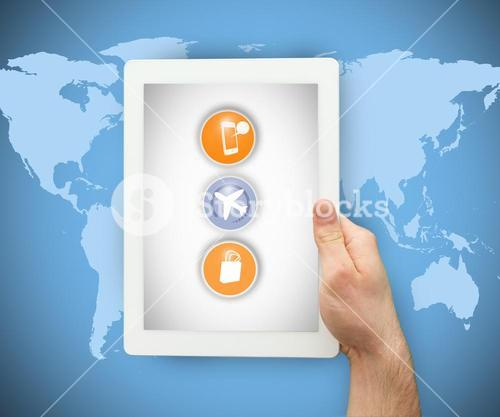 Person holding a tablet PC on world map background