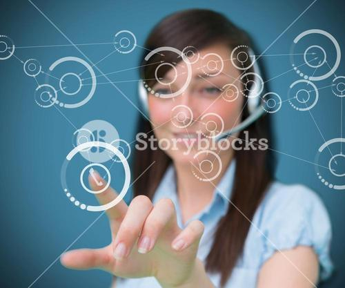 Woman selecting phone symbol from digital interface