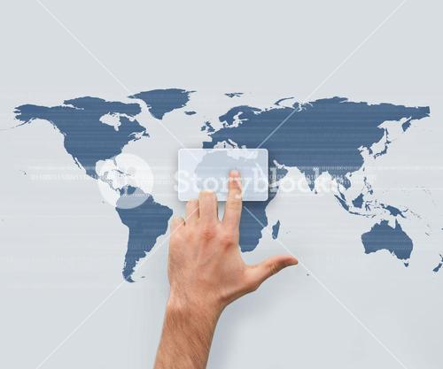 Hand pointing on digital box on world map