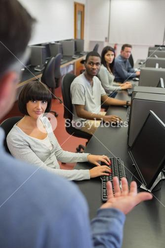 Teacher talking to the students in computer class