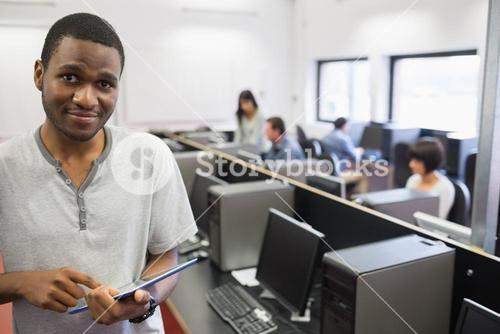 Student in computer room using tablet pc