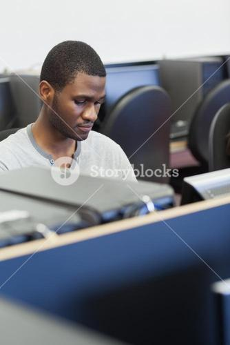 Man sitting at computer desk