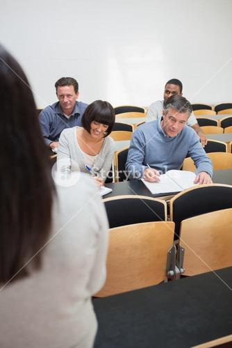 People taking notes in a lecture