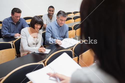 People taking notes in class