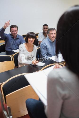 Man asking question in lecture