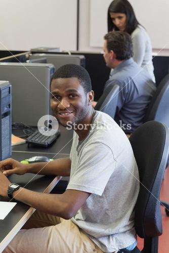 Happy student in computer class