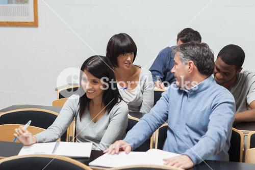 Students talking in lecture hall