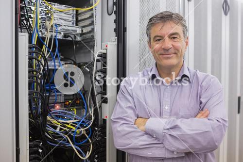 Smiling technician with arms crossed