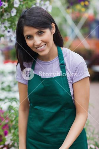 Smiling garden center worker