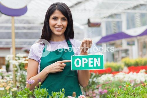 Woman pointing at the open sign
