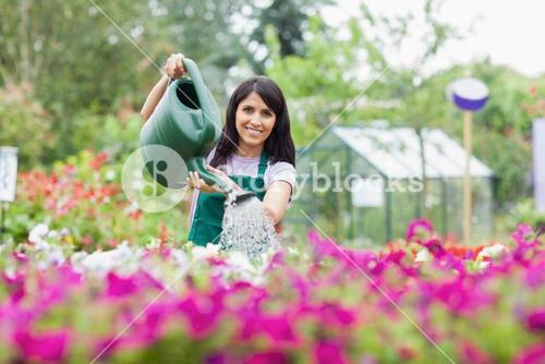Happy employee watering plants