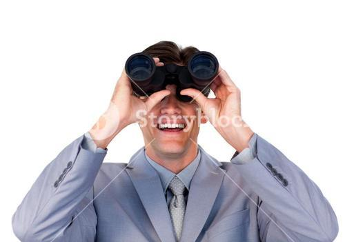 Enthusiastic businessman looking through binoculars