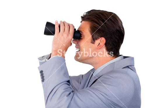 Happy businessman using binoculars