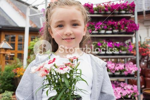 Child holding potted plant