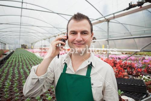 Employee on the phone in greenhouse