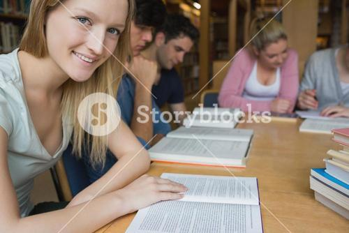 Smiling student with study group