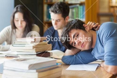 Tired student resting in library