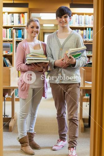 Couple standing at the library holding books