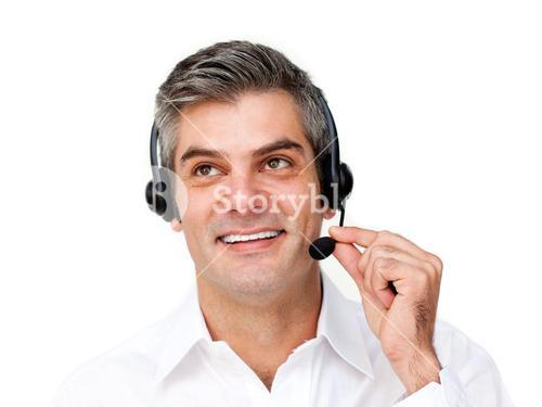 Selfassured businessman using headset