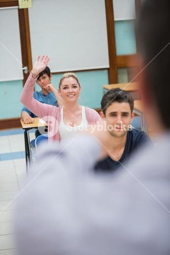 Woman asking question in class