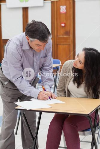 Teacher helping student with work