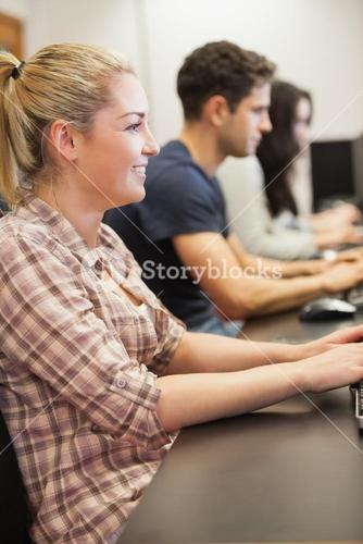 Woman sitting typing at computer class