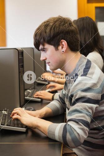Man sitting at computer desk typing