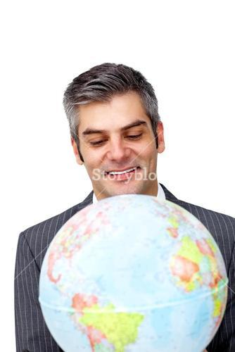 Confident businessman smiling at global business expansion