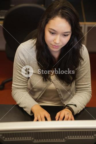 Concentrate woman sitting at the computer