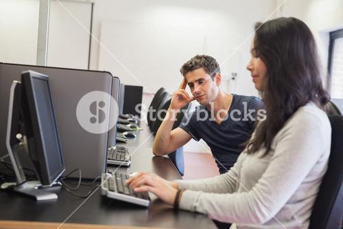 People sitting at the computer room