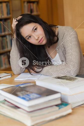 Stressed student in a library