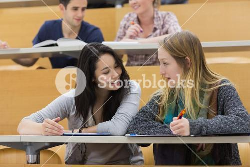 Talking students in a lecture hall