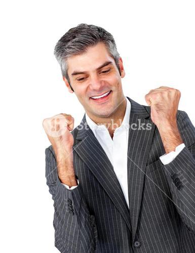 Mature businessman punching the air in celebration