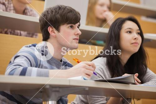 Students paying attention while sitting in a lecture hall