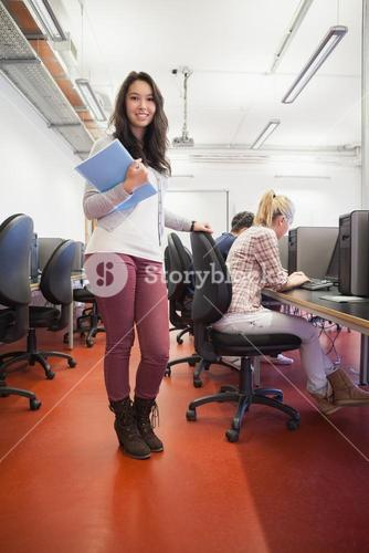 Smiling student in a computer room