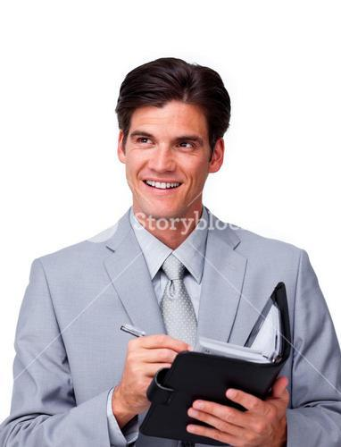 Attractive businessman holding an agenda