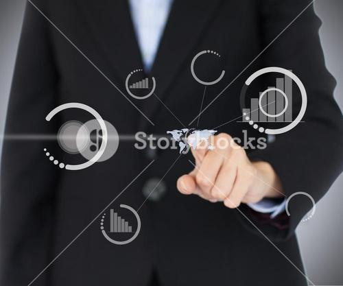 Businessman pointing on a virtual screen