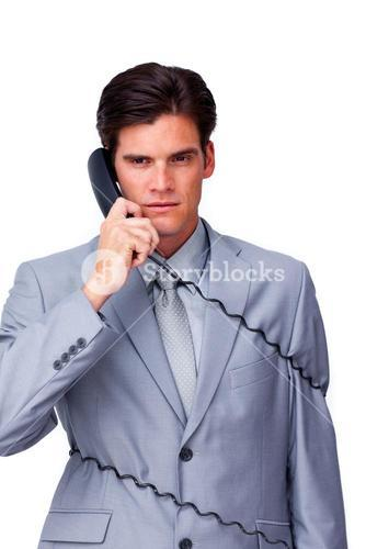 Annoyed businessman tangle up in phone wires