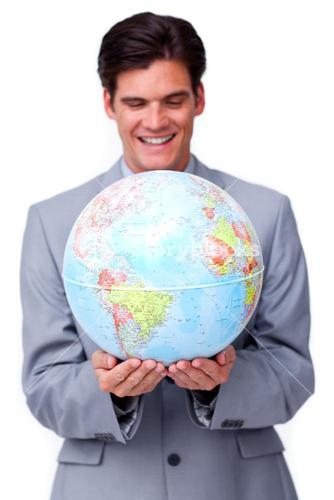 Assertive businessman smiling at global business expansion