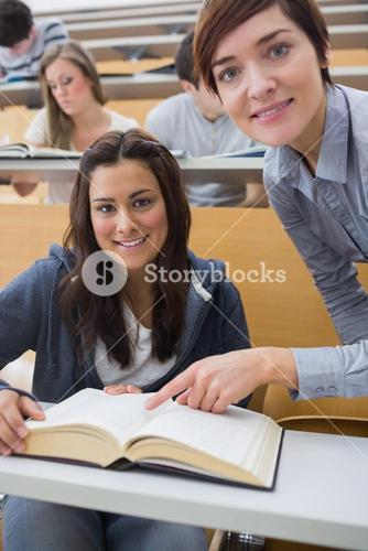 Smiling student and lecturer with book