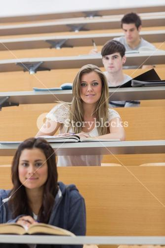 Students sitting smiling in lecture hall