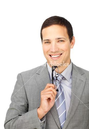 Confident young businessman holding glasses