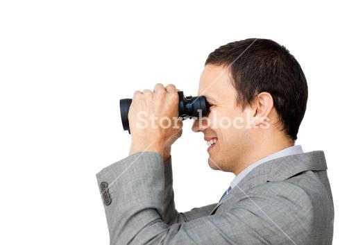 Smiling businessman using binocular