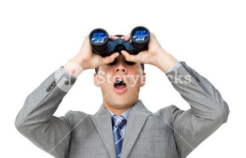 Businessman using binocular