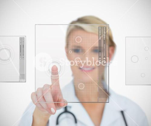 Doctor standing smiling while pressing on interface