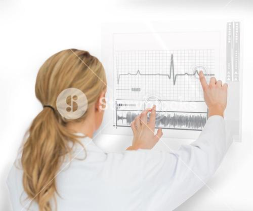 Doctor using heart rate interface