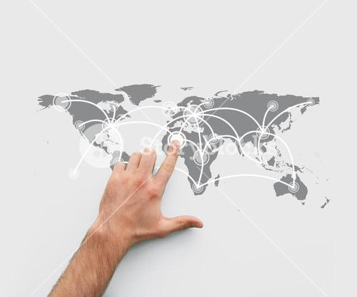 Finger pointing a map showing world connections